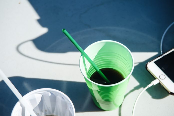 Drinking vegetable juice by the pool